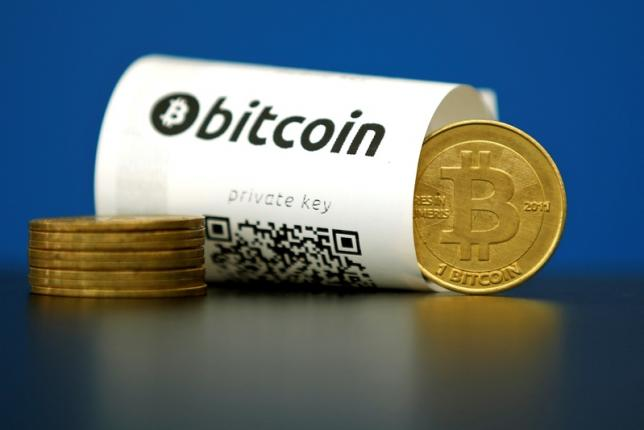 Bitcoin image from Reuters/Benoit Tessier
